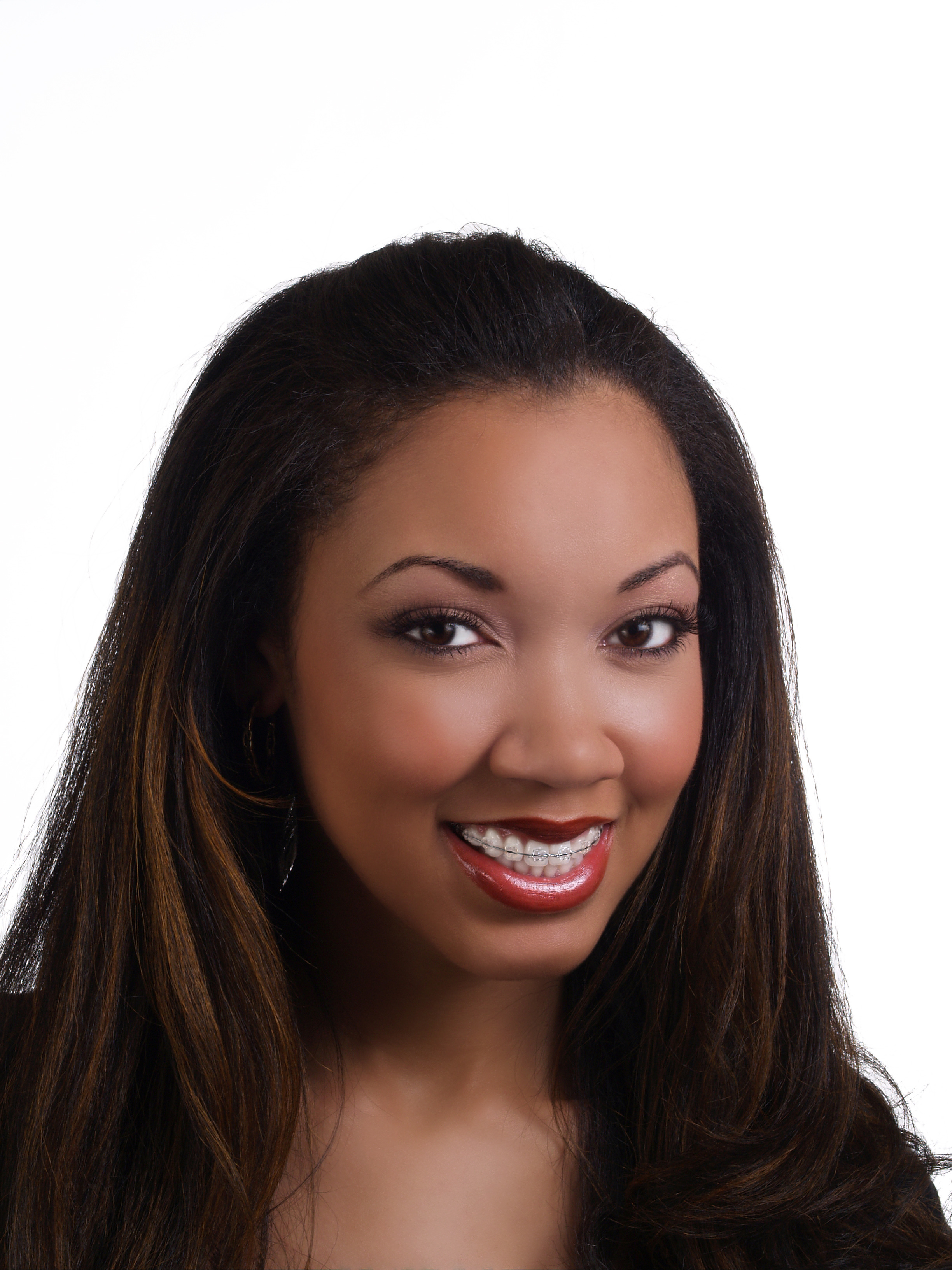 Portrait young black woman orthodontist braces